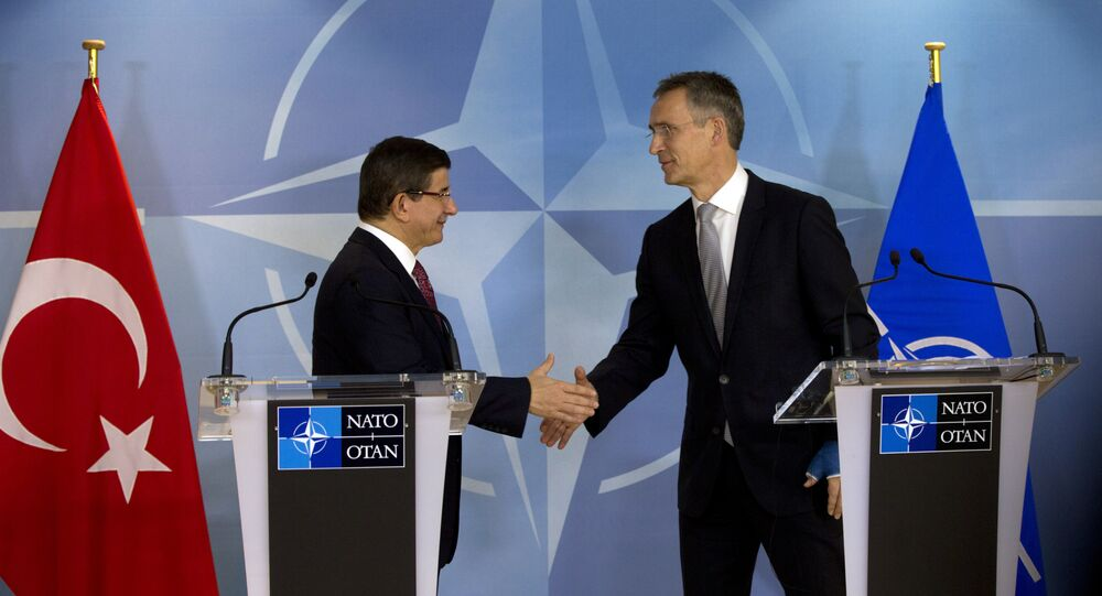 Turkish Prime Minister Ahmet Davutoglu shakes hands with NATO Secretary General Jens Stoltenberg after addressing a media conference at NATO headquarters in Brussels.