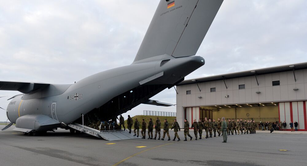 Personnel of the 51st squadron Immelmann enter an Airbus A400M military aircraft before taking off from the German army Bundeswehr airbase in Jagel, northern Germany, December 10, 2015