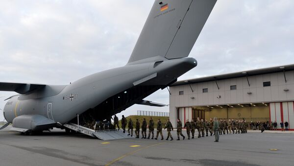 Personnel of the 51st squadron Immelmann enter an Airbus A400M military aircraft before taking off from the German army Bundeswehr airbase in Jagel, northern Germany, December 10, 2015. Germany deploys two Tornado reconnaissance jets and 40 troops to Turkey to back the fight against the Islamic State group in Syria - Sputnik International