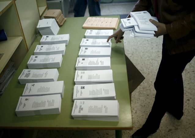 An election worker prepares ballots ahead of Spain's general election at a school in Los Prados, a small hamlet near the city of Ronda, southern Spain