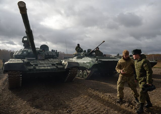 A T-72 tank goes through fields trials at Chebrakul base