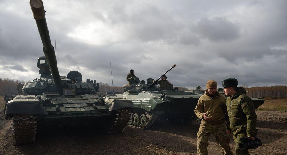 A T-72 tank goes through fields trials at Chebrakul base