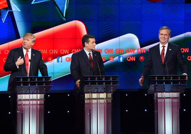 Republican presidential hopefuls Donald Trump (L), Ted Cruz (C) and Jeb Bush (R) on stage at the Republican Presidential Debate, hosted by CNN, at The Venetian Las Vegas on December 15, 2015 in Las Vegas, Nevada.