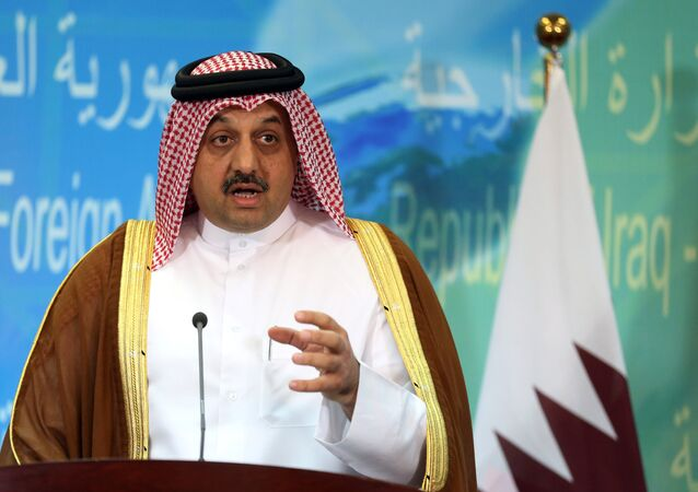 Qatari Foreign Minister Khalid bin Mohammed al-Attiyah speaks during a press conference with his Iraqi counterpart Ibrahim al-Jaafari in Baghdad, Iraq, Friday, May 29, 2015.