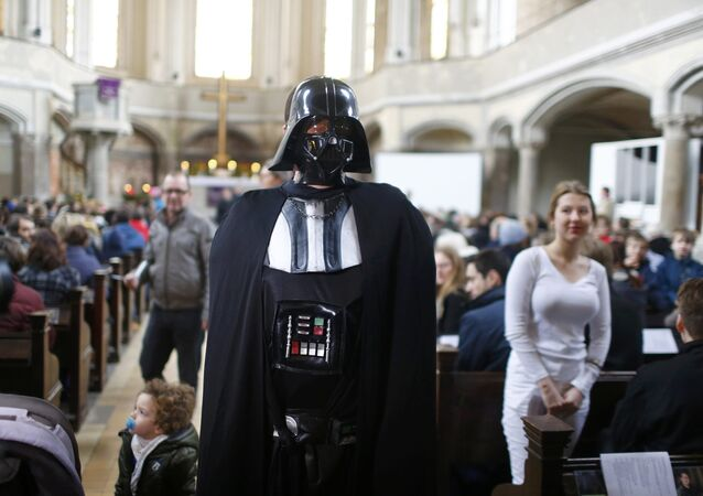 People dressed as characters from the movie Star Wars attend a service at the church Zionskirche in Berlin, Germany
