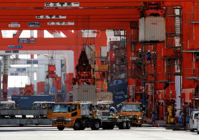 Containers are loaded onto trailer trucks at the international cargo terminal at Tokyo's port on November 19, 2015