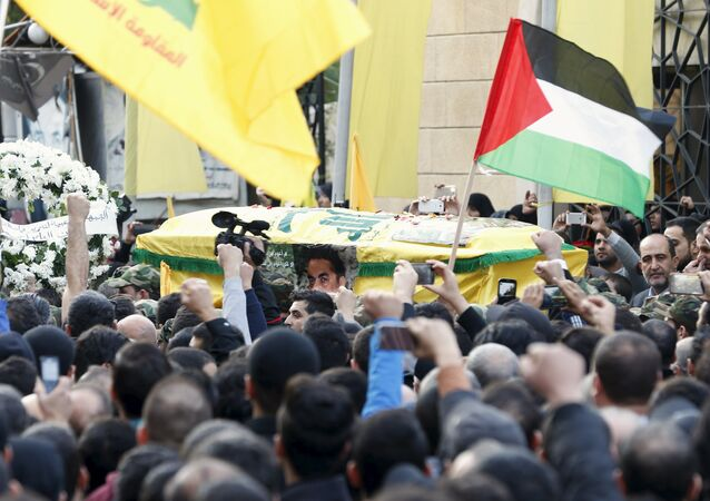 Hezbollah members carry the coffin of Lebanese Hezbollah militant leader Samir Qantar, as supporters carry Palestinian and Hezbollah flags during his funeral in Beirut's southern suburbs, Lebanon December 21, 2015