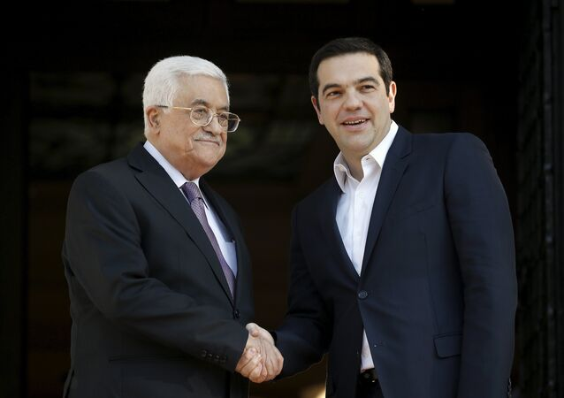Greek Prime Minister Alexis Tsipras (R) welcomes Palestinian President Mahmoud Abbas at the Maximos Mansion in Athens, Greece, December 21, 2015.