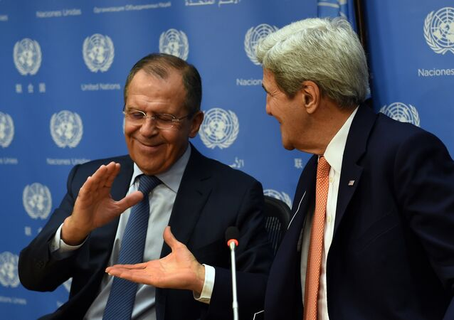 Foreign Minister of Russia Sergey Lavrov (L) and US Secretary of State John Kerry shake hands