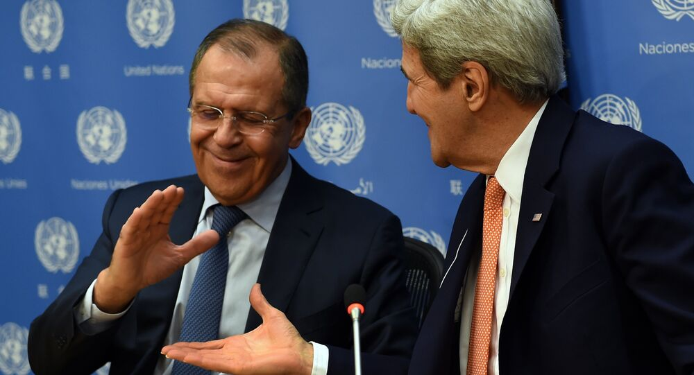 A file photo of Foreign Minister of Russia Sergey Lavrov (L) and US Secretary of State John Kerry shake hands
