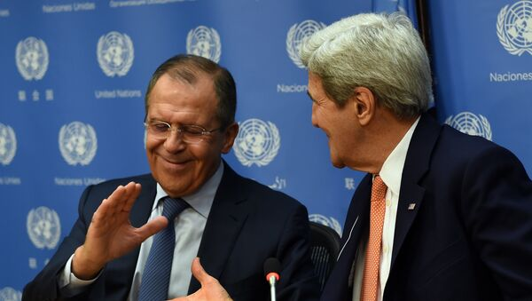 Foreign Minister of Russia Sergey Lavrov (L) and US Secretary of State John Kerry shake hands - Sputnik International