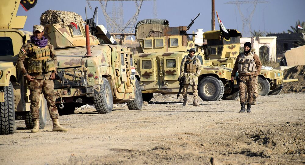 Iraqi soldiers advance their position in northern Ramadi, 70 miles (115 kilometers) west of Baghdad, Iraq, Monday, Dec. 21, 2015