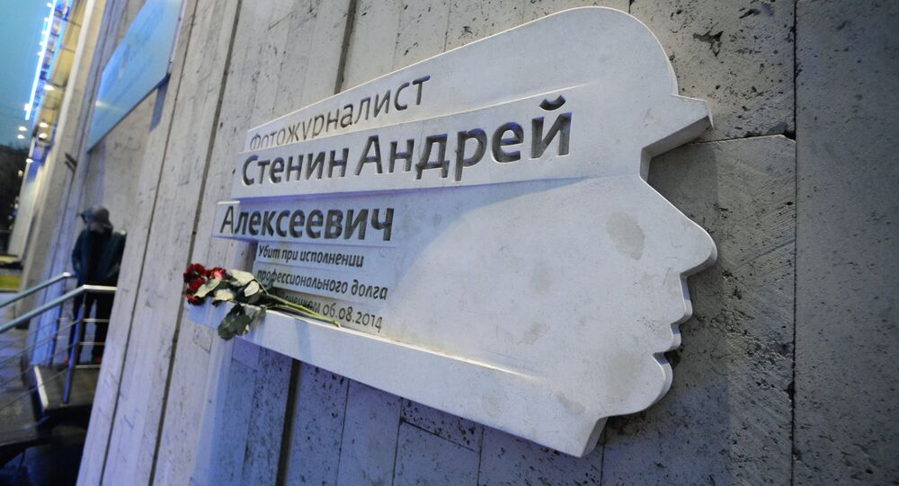 A memorial plaque on the wall of the Rossiya Segodnya International Information Agency honoring Rossiya Segodnya press photographer Andrei Stenin who was killed in the line of duty in 2014 in Ukraine.