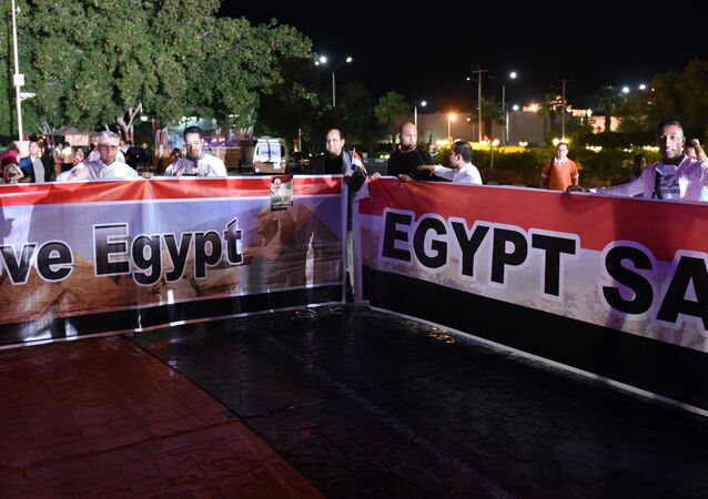 People take part in a march in Naama Bay, a popular area of Sharm el-Sheikh, as part of an initiative to encourage tourism, on November 12, 2015.