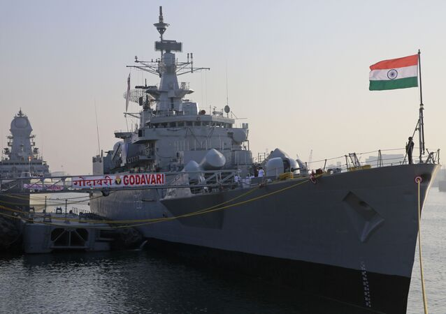Indian navy personnel stand on board war ship Godavari during its decommissioning at the naval dockyard in Mumbai, India, Wednesday, Dec. 23, 2015.