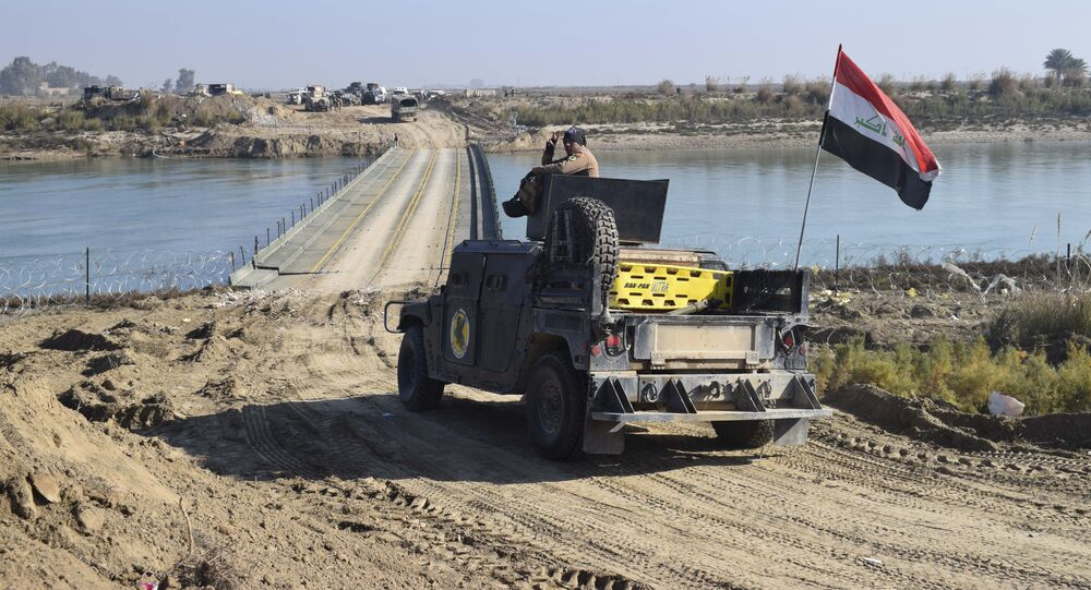 Iraqi security forces cross a bridge built by corps of Engineers over the Euphrates River as Islamic State destroyed all the bridges leading to central Ramadi to block Iraqi security forces from moving forward in Ramadi, 70 miles (115 kilometers) west of Baghdad, Iraq, Tuesday, Dec. 22, 2015