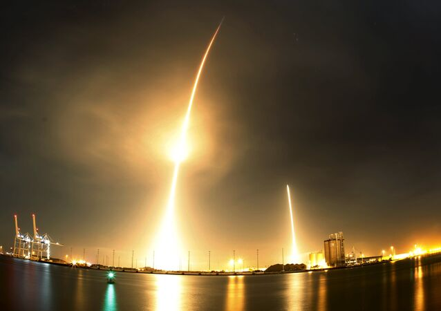 A long exposure photograph shows the SpaceX Falcon 9 lifting off (L) from its launch pad and then returning to a landing zone (R) at the Cape Canaveral Air Force Station, on the launcher's first mission since a June failure, in Cape Canaveral, Florida, December 21, 2015