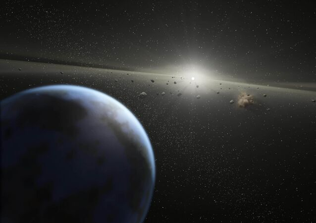 This artist's rendition released 20 April, 2005 by NASA shows a massive asteroid belt in orbit around a star the same age and size as our Sun