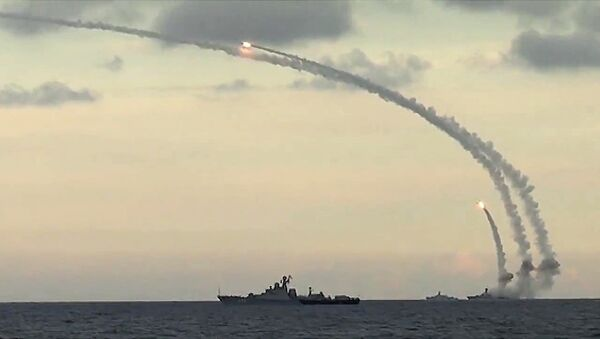 Ships from Russia's Caspian Flotilla launching Kalibr-NK cruise missiles against Daesh targets in Syria. File photo - Sputnik International