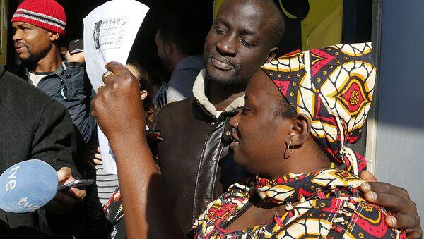Refugee wins lottery in Spain - Sputnik International
