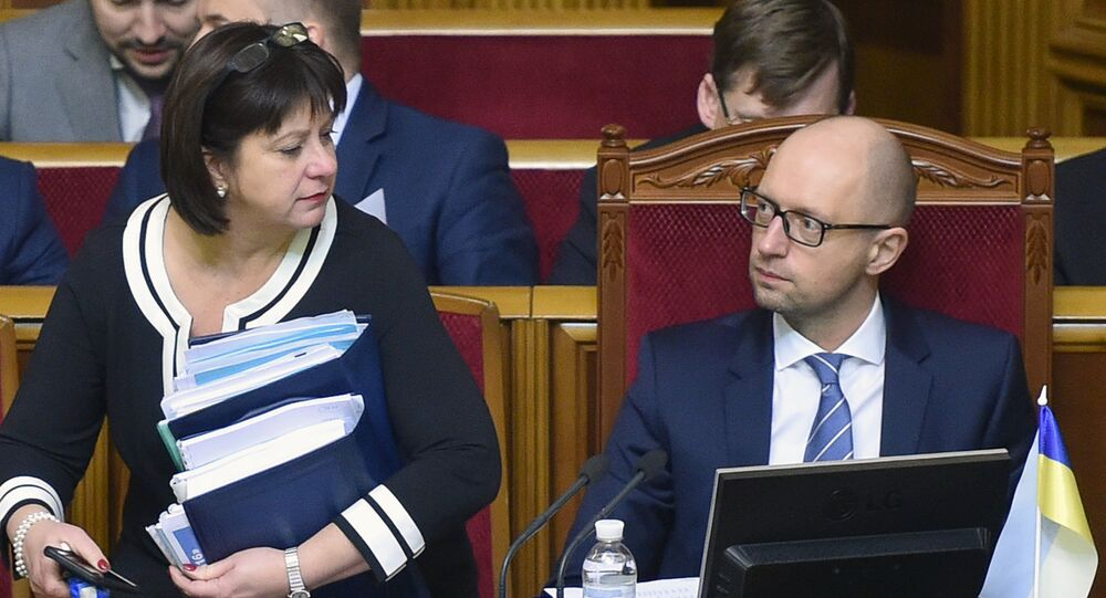 Finance Minister Natalia Yaresko (L) and Ukrainian Prime Minister Arseny Yatsenyk (R) prepare to present the draft of the new state budget during the parliament hearing in Kiev on December 17, 2015