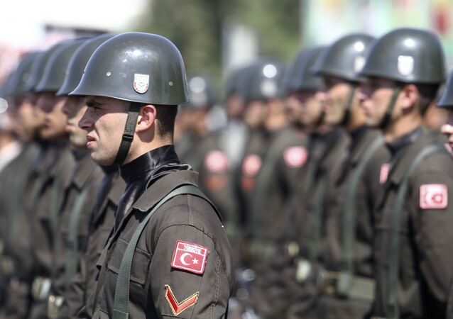 Turkish soldiers attend an army parade marking the 38th anniversary of the Turkish military invasion of Cyprus, on July 20, 2012 in Nicosia, in the northern Turkish-controlled area of the of the east Mediterranean island