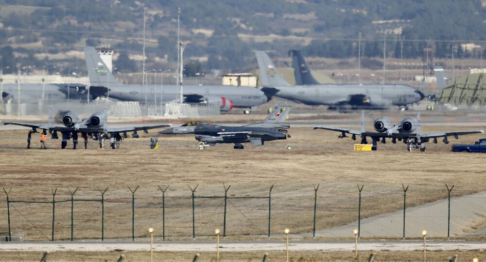 A Turkish Air Force F-16 fighter jet ( C foreground) is seen between US Air Force A-10 Thunderbolt II fighter jets at Incirlik airbase in the southern city of Adana, Turkey, December 11, 2015.