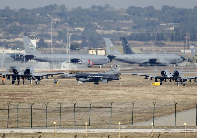 A Turkish Air Force F-16 fighter jet ( C foreground) is seen between US Air Force A-10 Thunderbolt II fighter jets at Incirlik airbase in the southern city of Adana, Turkey, file photo