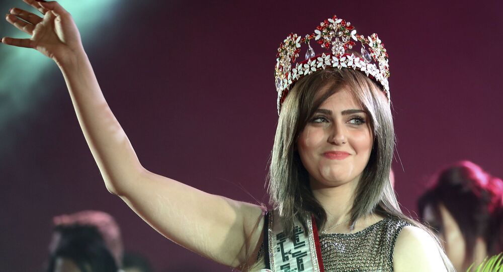 Newly crowned Miss Iraq, 20-year old Shaima Qassim, celebrates after being crowned at the end of the 2015 Miss Iraq Final in Baghdad, Iraq, Saturday, Dec. 19, 2015