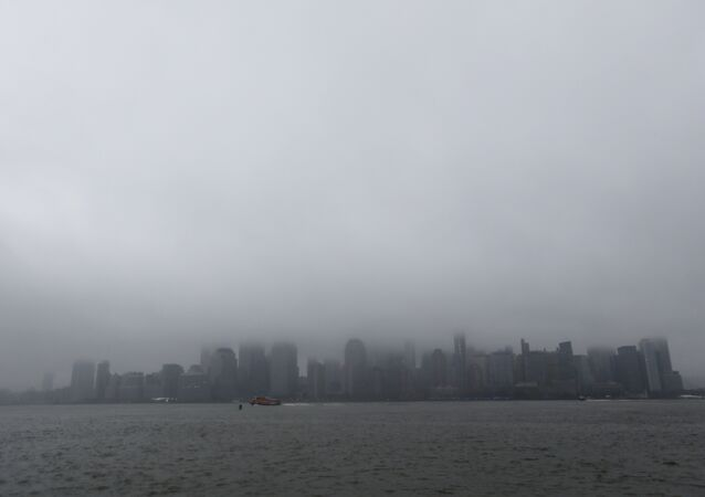 A boat chugs along the Hudson River as fog and clouds blanket over the New York City Skyline seen from Liberty State Park, Wednesday, Dec. 23, 2015, in Jersey City, N.J