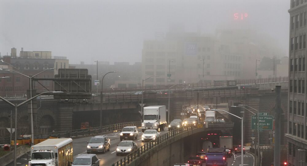 Traffic passes along a foggy Brooklyn Queens Expressway, Wednesday, Dec. 23, 2015 in New York. A weather pattern partly linked with El Nino has turned winter upside-down across the U.S. during a week of heavy holiday travel, bringing spring-like warmth to the Northeast, a risk of tornadoes in the South and so much snow across the West that even skiing slopes have been overwhelmed