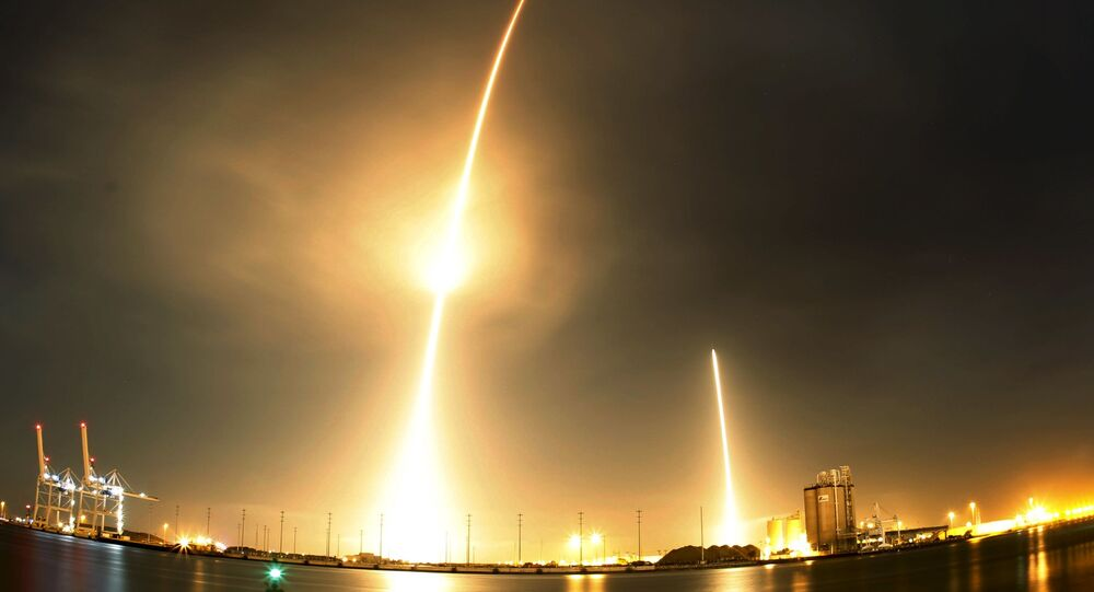 A long exposure photograph shows the SpaceX Falcon 9 lifting off (L) from its launch pad and then returning to a landing zone (R) at the Cape Canaveral Air Force Station, on the launcher's first mission since a June failure, in Cape Canaveral, Florida, December 21, 2015.
