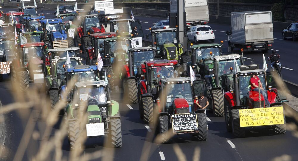 Angry farmers drive their tractors on the Paris ring, Thursday, Sept.3, 2015 in Paris, France