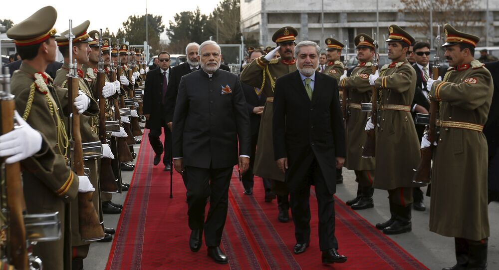 India's Prime Minister Narendra Modi (L) and Afghan Chief Executive Officer Abdullah Abdullah inspect honour guards at the Kabul international airport, after his trip to Kabul, Afghanistan December 25, 2015