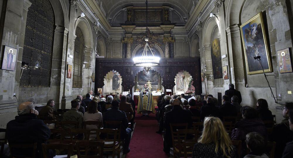 The faithfull attend a Christmas Eve mass at the Syriac Catholic Church of Saint Ephrem in Paris, on December 24, 2015