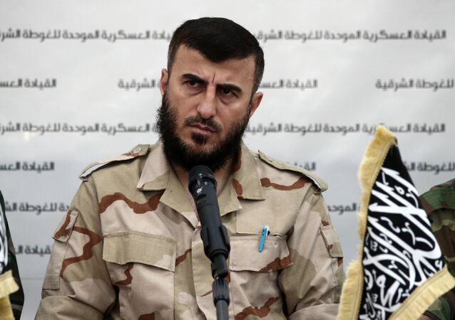 Zahran Alloush, the leader of Jaysh al-Islam (Islam Army) and military leader of the Islamic Front, attends a press conference with other brigade leaders in the rebel-held Eastern Ghouta region outside the capital Damascus on August 27, 2014, to announce the fomation of The Unified Military Command of Eastern Ghouta