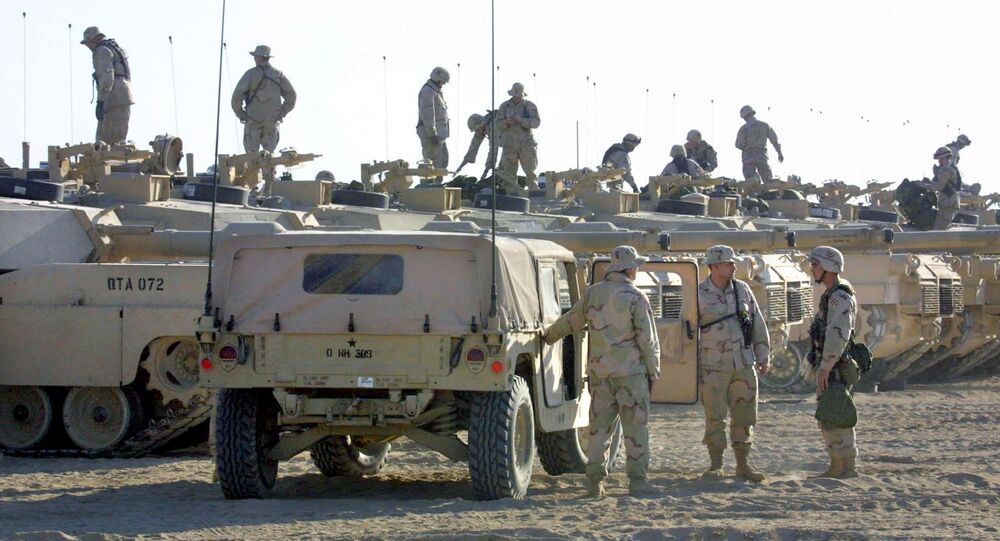 US troops are seen on top of their tanks, as others chat next to an armored vehicle (File)