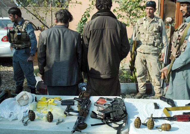 File photo: Afghan security forces stand guard around two arrested so-called IS fighters in Jalalabad, capital of Nangarhar province, Afghanistan, Wednesday, Dec. 23, 2015
