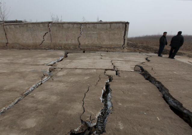 A damaged wall and roads are seen after a gypsum mine collapsed on Friday morning, in Pingyi, Shandong province, December 25, 2015