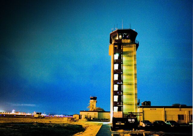 The air traffic controller tower overlooks entire flight line at Yokota Air Base, Japan, March 24, 2011