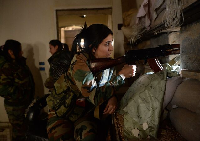 Female snipers from a special weapons and tactics (SWAT) regiment of the Syrian Arab Army in Darayya, a Damascus suburb