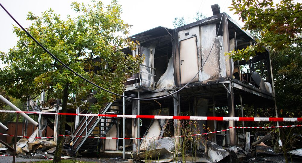 Burned out mobile homes are seen at a refugee shelter on October 18, 2015 in Hamburg, northern Germany (File)