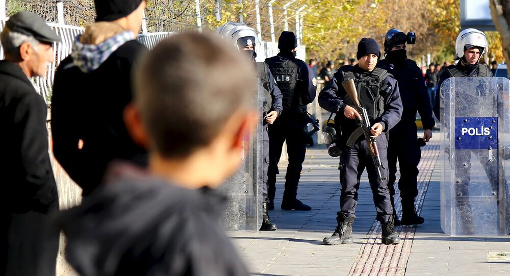 Turkish riot police stand guard during a protest against the curfew in Sur district in the Kurdish dominated southeastern city of Diyarbakir, Turkey, December 6, 2015.