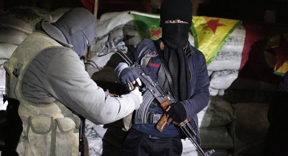 The militants of the Kurdistan Workers' Party, or PKK, stand at a barricade in Sirnak, Turkey, late Wednesday, Dec. 23, 2015.