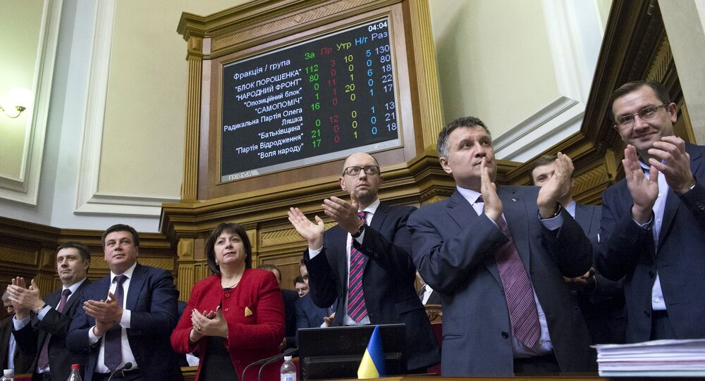 Ukraine's Prime Minister Arseny Yatseniuk (3rd R), Finance Minister Natalia Yaresko (4th R), Interior Minister Arsen Avakov (2nd R) and other ministers react after parliament approved the budget during a session in Kiev, Ukraine, December 25, 2015