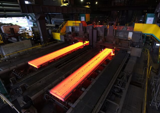 The picture shows red hot steel being flattened in the hot rolling plant at the ThyssenKrupp steel mill Hamborn in Duisburg , western Germany