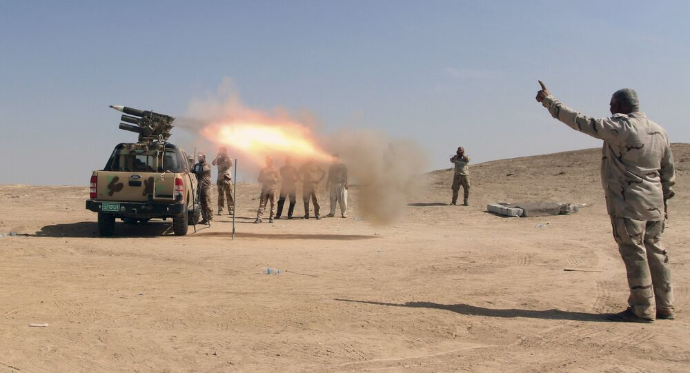 Iraqi security forces and allied Popular Mobilization Forces fire rockets at Daesh positions at an oil field outside Beiji, some 250 kilometers (155 miles) north of Baghdad, Iraq, Saturday, Oct. 24, 2015