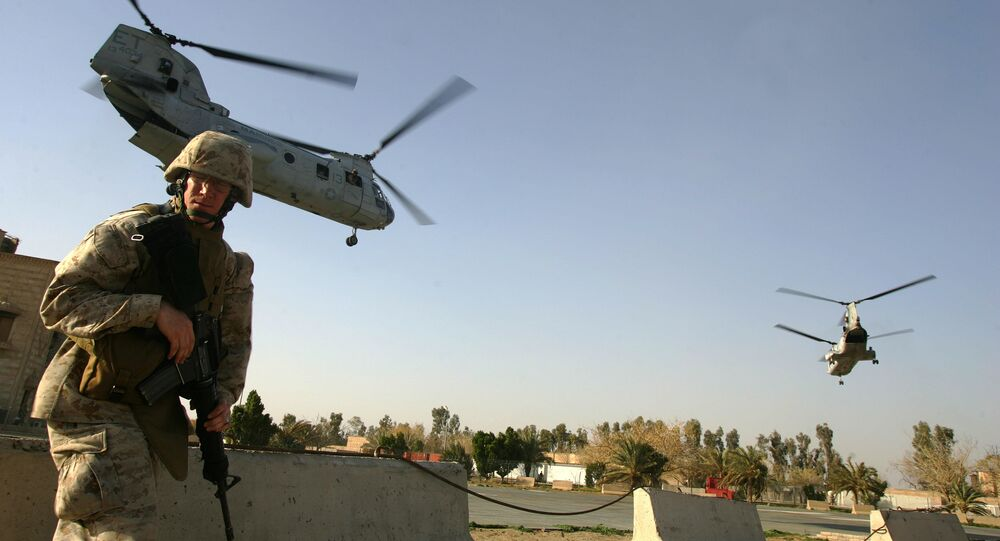 US marine ducks as CH-46 Sea Knight helicopters take off from Ramadi . file photo