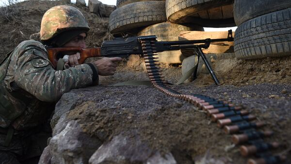 A picture taken on February 16, 2015 shows an Armenian serviceman guarding an area near the village of Movses, close to the border with Azerbaijan - Sputnik International