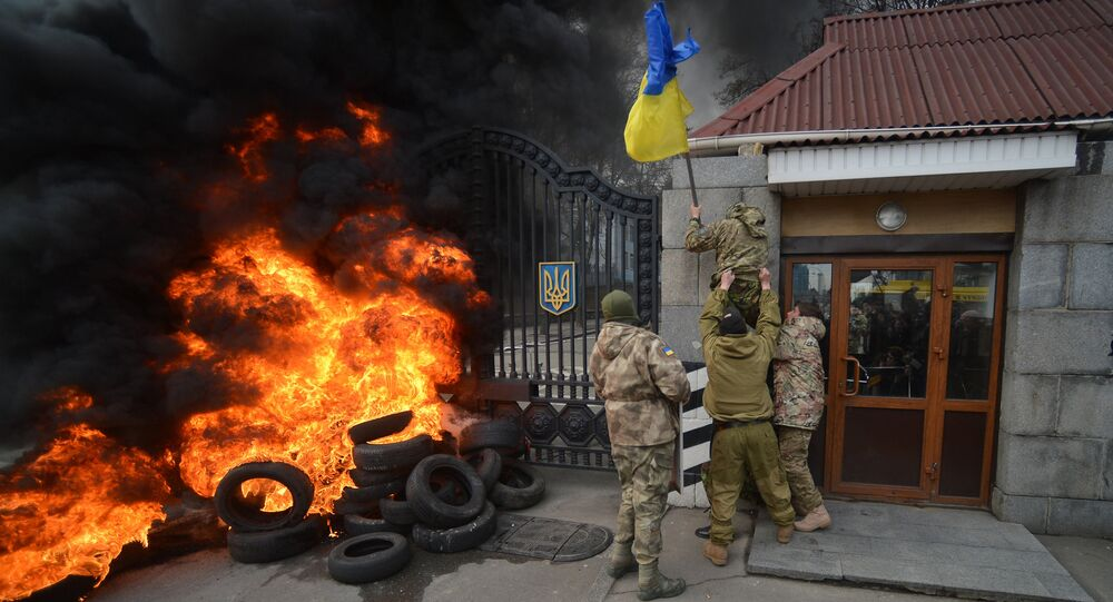 Fighters of Aidar Battalion try to storm the gate of the building of the Ukraine Ministry of Defence in Kiev during their protest action
